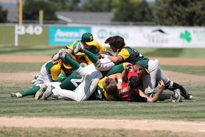 The Renner Monarchs team dogpiles after winning their 2021 Class A State Amateur Baseball Championship over the Harrisburg Hops 2-0 SUnday August 15th in Mitchell, SD.