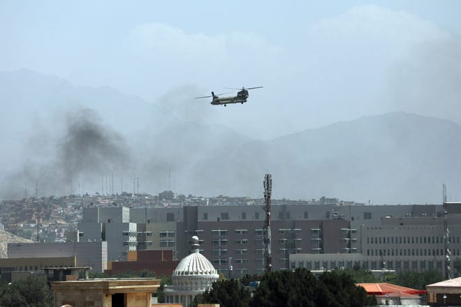 A U.S. Chinook helicopter flies over the city of Kabul on Aug. 15, 2021. Political leaders in Missouri weighed in following the fall of Afghanistan's government to the Taliban, levying criticisms ranging from the Biden administration, U.S. foreign policymaking and the 20-year war as a whole.
