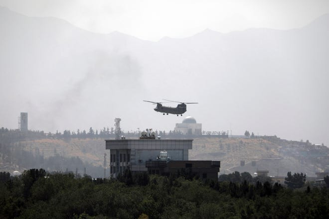 A U.S. helicopter flies over the U.S. Embassy in Kabul, Afghanistan, on Aug. 15, 2021.