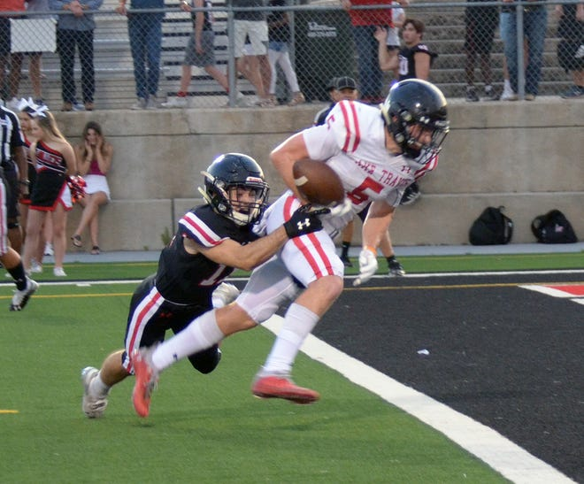 """Lake Travis senior Isaac Norris, right, tries to drag safety Jackson Young into the end zone during the Cavs' spring game. The versatile Norris, whom Lake Travis coach Hank Carter calls """"a football-playing dude,"""" will perform a variety of roles for the Cavs in 2021."""