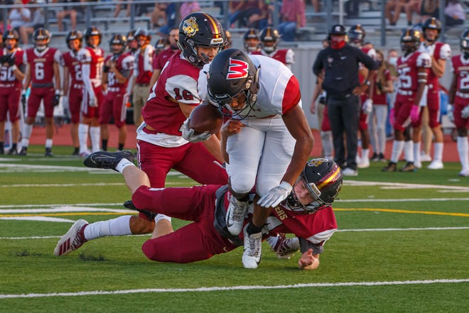 Weiss running back Daelen Alexander dives across the goal line for the touchdown against Rouse during the 2020 season. Alexander will pair up with Tory Simmons for the bulk of the running back carries for the Wolves in 2021.