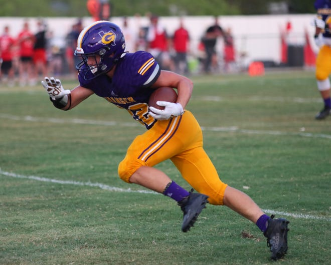 Granger running back Donnie Cantwell surges forward on a breakout run versus Axtell in the 2020 season. Cantwell returns to lead the Lion rushing attack after totaling 672 yards on the ground last year.