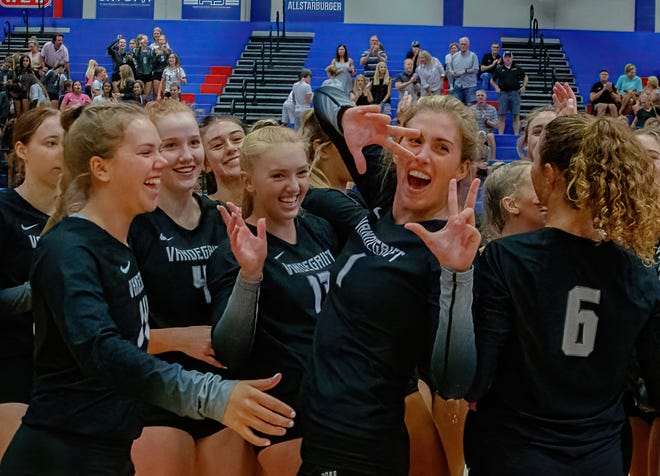 Vandegrift's Chloe Charles, right, celebrates after a win over Westlake in the season opener last week. Charles earned MVP honors at this past weekend's Westwood Invitational, which Vandegrift won without dropping a match.