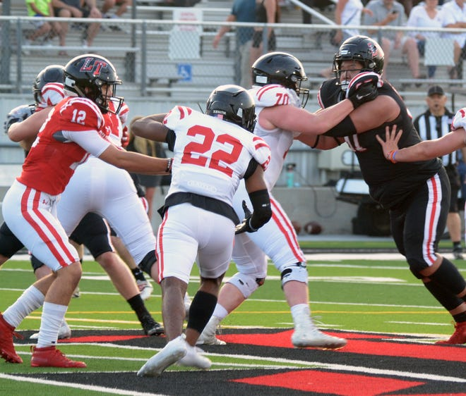"""Lake Travis defensive tackle Jaden Nguyen, right, fights off the block of Adam Muscariello during the Cavs' spring game in May. Nguyen played on the Cavs' varsity team as a sophomore but missed last season after a heat stroke in summer workouts. Now healthy and cleared to play football again, Nguyen says he's """"better than ever."""""""