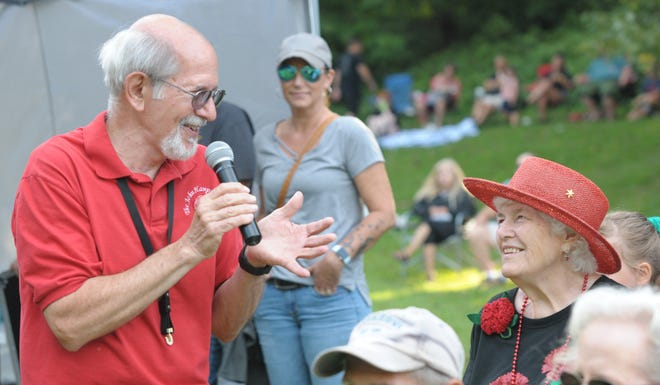 Bandleader John Hampu sings to a fan Saturday, Aug. 14, 2021, during a Greater Alliance Carnation Festival Days in the Park show at Silver Park.