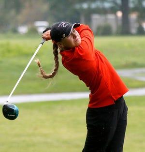Ashland High School's Klaira Paramore hits a tee shot during the George Valentine Invitational at Brookside Golf Course on Monday, Aug. 16, 2021. TOM E. PUSKAR/TIMES-GAZETTE.COM
