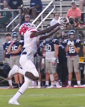 Junior wide receiver Tacorey Grant stretches out to reel in a pass from Screven County quarterback Jake Pollock in the Gamecocks' Aug. 13 scrimmage on the road at Effingham County.