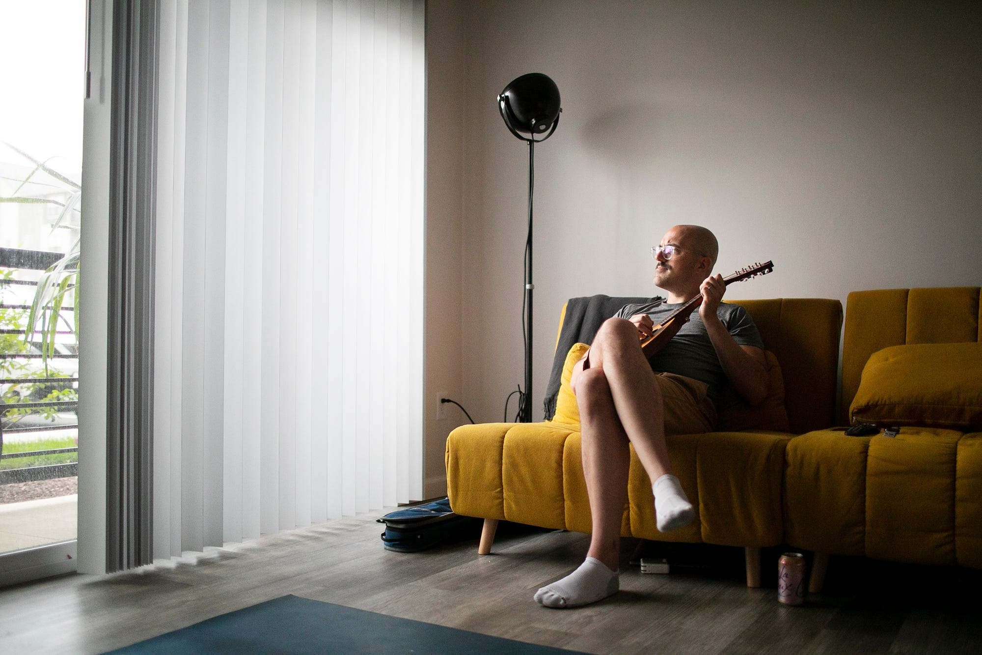 Chris Graham plays a mandolin at home in Westerville after an intense Eye Movement Desensitization and Reprocessing (EMDR) psychotherapy session. Therapy has helped Graham recover repressed memories of being raped by a Columbus priest when he was 14 years old.