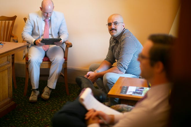 Chris Graham, 39, meets with Ohio Sen. Stephanie Kunze, a Hilliard Republican, and members of her staff to discuss priest abuse. Graham was raped by a priest in Columbus when he was 14 years old. He has suffered from PTSD since the attack, which was repressed until last year when memories started coming out through therapy.