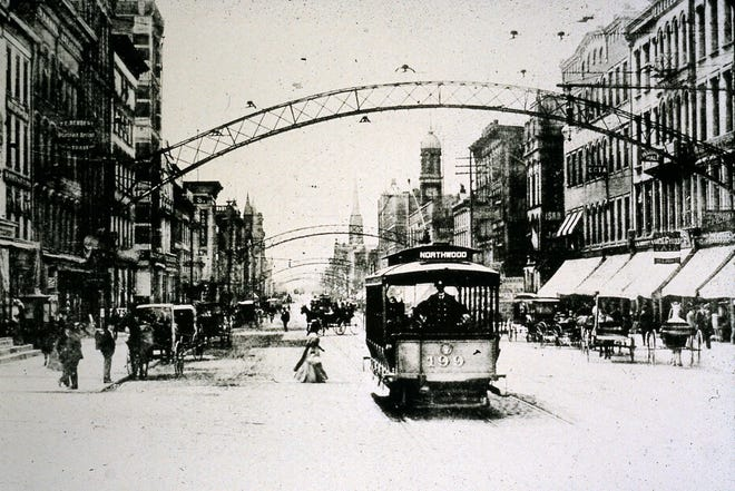 Lighted arches once adorned downtown streets, such as in this 1904 photo looking south from State and High streets.