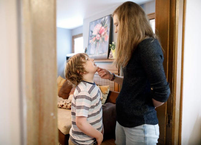 Included in this year's state budget is additional funding for children with a diagnosis of autism to access educational services from a specialized provider such as Bridgeway Academy and others around the state. Melissa Peppercorn, right, takes a moment and talks to her son Mikey Heine, 8, before his first day of school at Bridgeway Academy on Aug. 16.