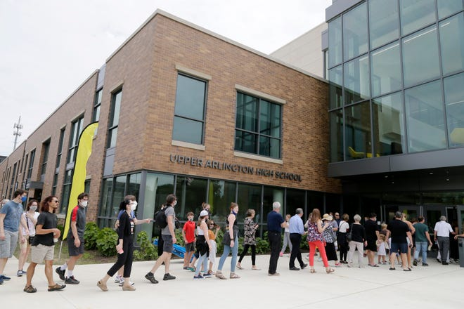 A long line of people wait to enter a grand opening celebration at the new Upper Arlington High School at 1625 Zollinger Road.