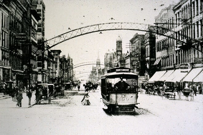 Arch City indeed: Lighted arches once adorned Downtown streets, such as in this 1904 photo looking south from State and High streets.