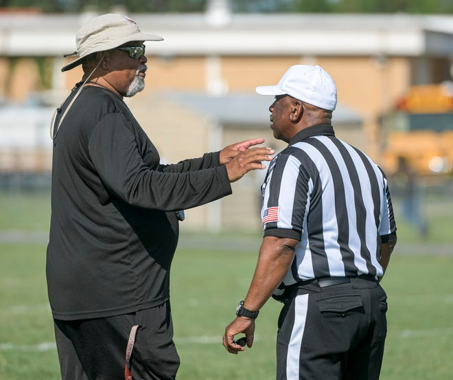 Leesburg head coach Mark Oates speaks with an official during Saturday's  preseason jamboree at Leesburg High School. The six-team jamboree provided officials, coaches and players with a chance to get game action in before this week's Kickoff Classics are played. [PAUL RYAN / CORRESPONDENT]