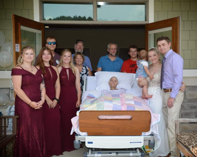 Ohio's Hospice Lifecare patient Crystal Mackey celebrates a special, small wedding  ceremony of her daughter, Courtney, to Nick Letterly from the patio of the facility's inpatient pavilion on July 18 before Mackey died on Aug. 5. The scheduled wedding ceremony for the couple still will take place Aug. 28.