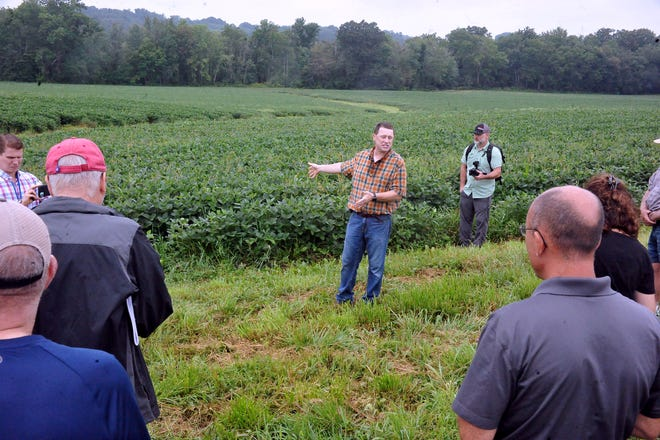 Scott Myers explains to a group how soybeans are grown on his Wayne County farm.