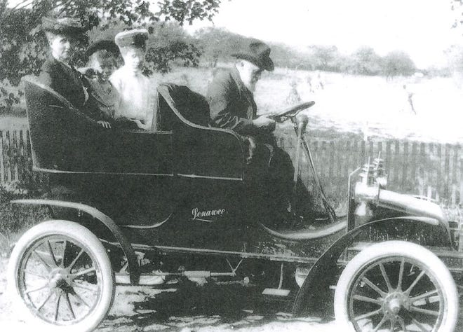 """The Clement family of Adrian enjoy an outing in their 1903 Lenawee automobile. The car is being driven by its developer, Walter Clement. The Lenawee had a """"planetary"""" transmission with gears, cogs and a clutch allowing the car to be driven at variable speeds. It also had a substantially stronger chassis system and a front-facing rear seat. The car could seat four adults."""