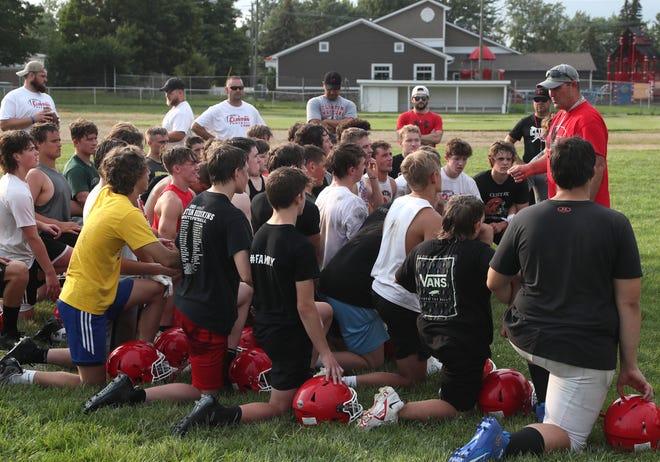 Clinton head coach Casey Randolph talks to the team during a practice on Monday, Aug. 9.