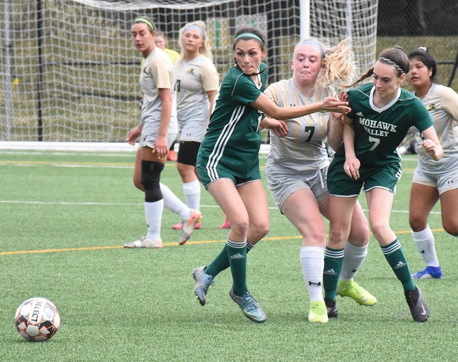 Herkimer College General Jazmyn Gillette fights her way between Mohawk Valley Community College Hawks Emily Berube (left) and Ciara Schaffner in pursuit of a loose ball during a match played April 9 in Herkimer.