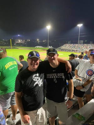 Larry Heath (left) and son Taylor enjoy the father-son experience at the Field of Dreams game Thursday in Dyersville.