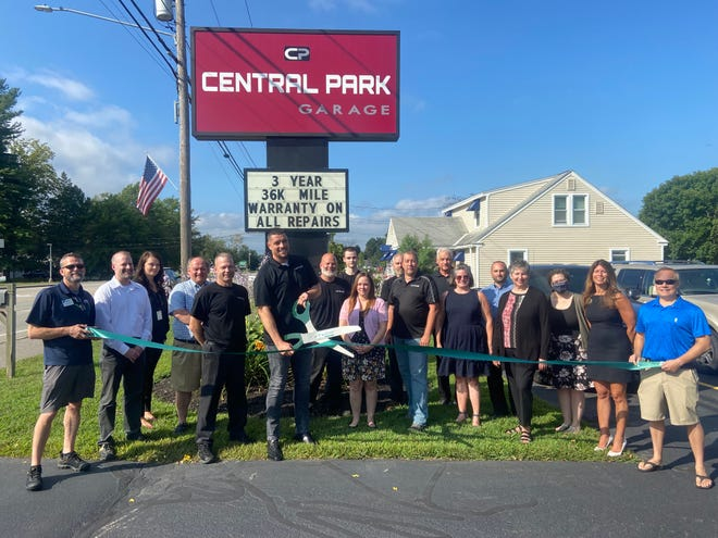 Dover Chamber representatives join the staff of Central Park Garage for a ribbon cutting ceremony to celebrate the auto repair shop joining the chamber.