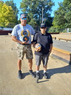 Blake Haverback, left, Dan Chapman, members of the Atkinson Bolders Rolle Bolle Club, invite area players to join them at the upcoming tournament to be held in conjunction with the annual Heritage Days celebration Aug. 27-28.