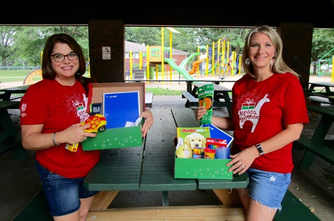 Shelly Emerick, left; and Mercedes Bealer, representing Operation Christmas Child, show samples of shoeboxes containing school supplies. Emerick said there is a need for more school supplies to be included in this year's shoeboxes. There is also a need for vendors for the Operation Christmas Child Craft & Vendor Fair to be Saturday, Aug. 28, in Geneseo City Park.