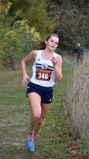 Hillsdale Academy's Megan Roberts running during last year's cross-country season.