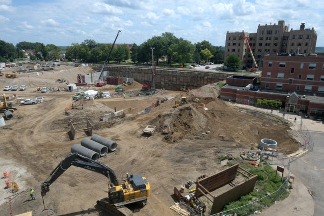 Construction workers prepare a 9-acre site beside OSF HealthCare Saint Francis Medical Center for the new Cancer Institute.