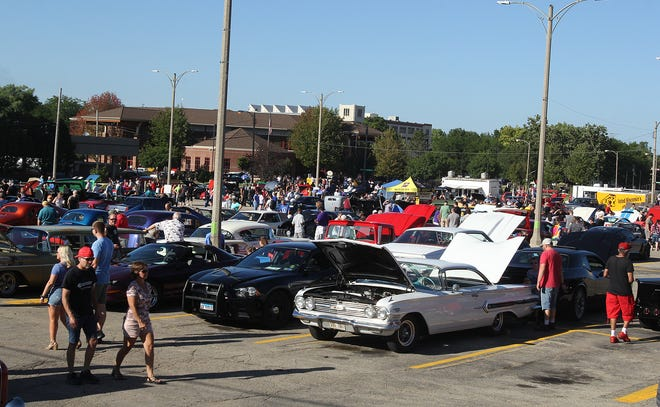 Crowds gather for the return of Cruise Night on Saturday, Aug. 14, 2021, in downtown Freeport. Cars lined the streets and filled parking lots for the return of the popular event, which was called off last year over coronavirus restrictions.