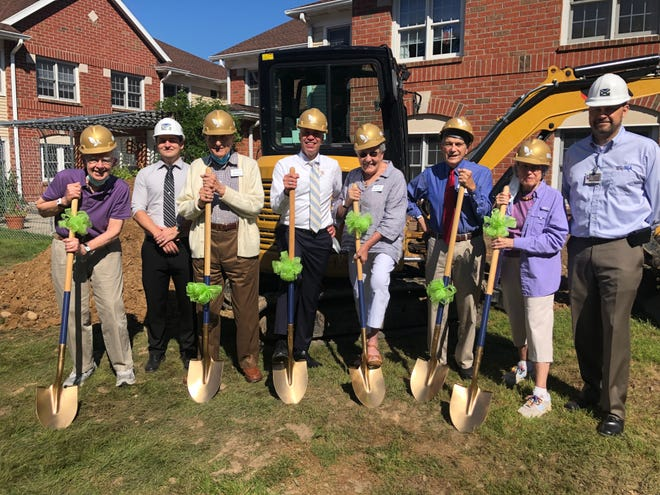 The Highlands Resident Council and Lloyd Theiss, executive director of the Pittsford retirement community, join representatives from DGA Construction Group to break ground on Laurelwood's new Assisted Living Memory Care Program, which should be completed in the spring.