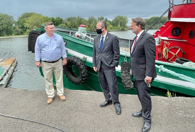Port of Monroe Director Paul LaMarre III discusses the port with Customs and Border Protection Acting Commissioner Troy Miller and Sen. Gary Peters, D-Mich. LaMarre took several CBP officials on a tour of the facility Monday afternoon.