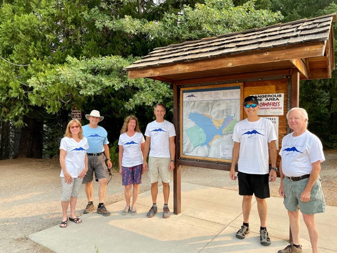 The Mount Shasta Trail Association board stands next to one of the completed kiosks at the Lake Siskiyou Trail.