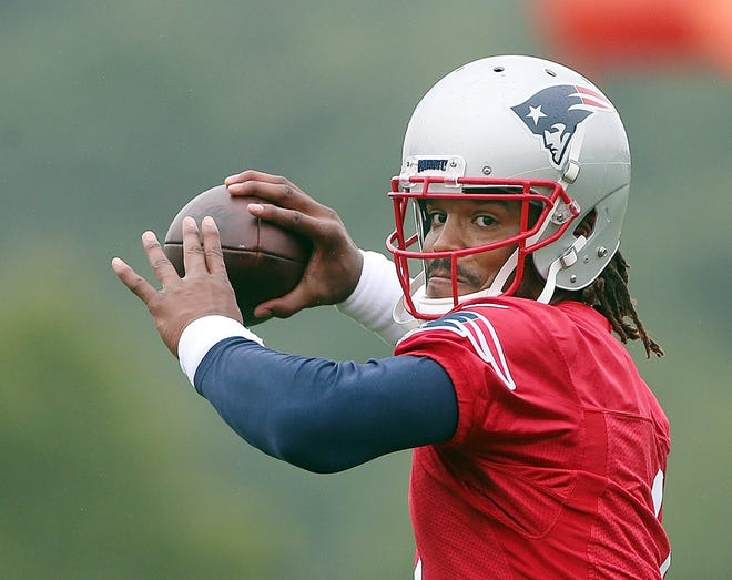 Cam Newton throws a pass during Patriots training camp last week at Gillette Stadium.