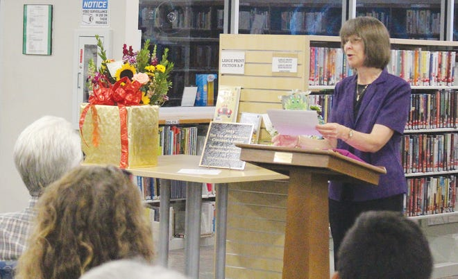 Lea Ann Holland shares her professional and personal journey of 50 years in library service with the commmunity at the Pratt Public Library during a special dedication service.