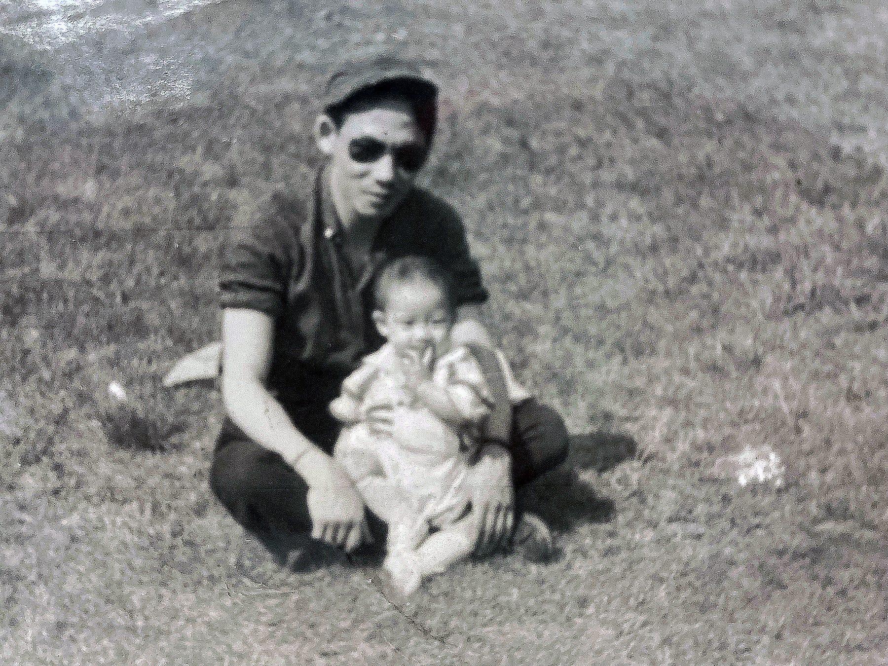 David Ng's father, Ng Chong Hing, with David as a baby.