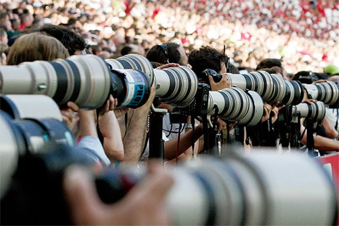 """Photographers use Canon's signature """"white"""" telephoto lenses at the 2020 Olympic Games in Tokyo."""