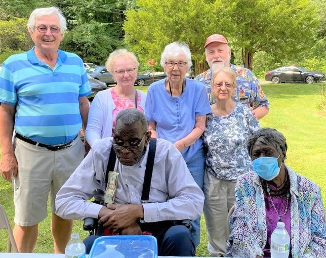 Members of the Kent Presbyterian Church were among those who gathered near Skeels Community Center in Ravenna Township to honor Herman Lee Counts, who is celebrating his 100th birthday. The church has a long history of celebrating with the people of Skeels. From left are, back row, Dave and Ruby Riley; Virginia Anderson; Eric and Kathy Halverson and, front row, Counts and Deseree Liddell.