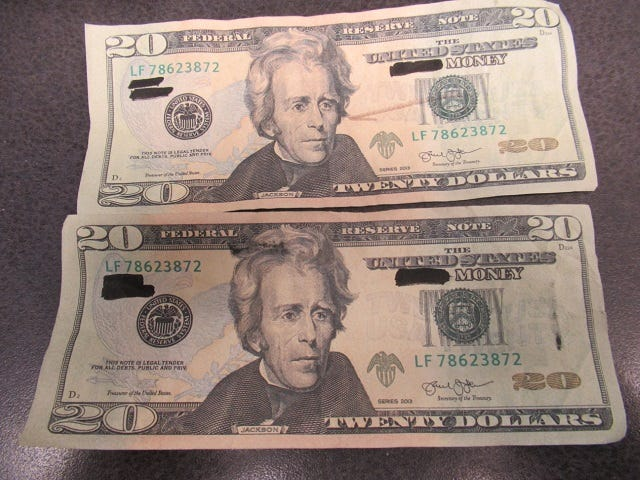 Daniel Armstead II of Canton is accused of passing these fake bills in Louisville on Aug. 9.
