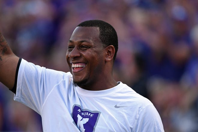 Former Kansas State quarterback Michael Bishop waves to the crowd at Bill Snyder Family Stadium during a 2017 game against Central Arkansas.