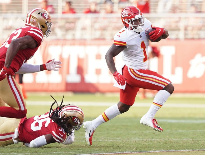 Kansas City Chiefs running back Jerick McKinnon (1) eludes a tackle by San Francisco 49ers defensive back Marcell Harris (36) on Saturday at Levi's Stadium.
