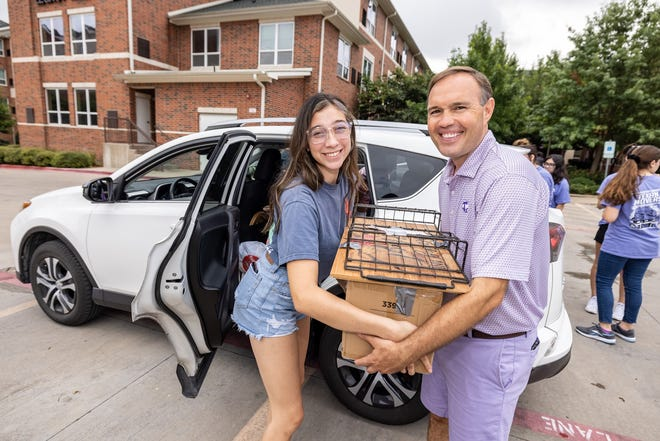 Tarleton State University President James Hurley, right, helps an incoming student move in to the dorms over the weekend in preparation for the upcoming school year. Fall classes at TSU are scheduled to begin on Thursday.