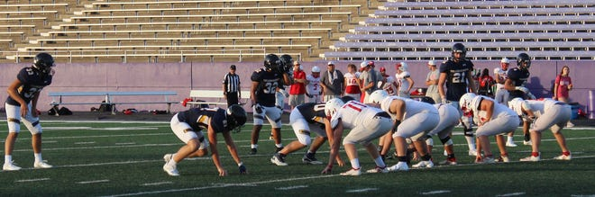 The Stephenville High School Yellow Jackets and Glen Rose Tigers faced off in a scrimmage on Friday at Tarleton's Memorial Stadium.