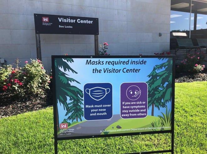 Signage outside the Soo Locks Visitor Center urging visitors to wear masks.