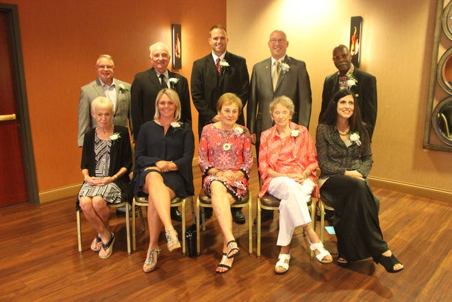 The 2020 Upper Peninsula Sports Hall of Fame class was finally inducted Sunday night at Island Resort & Casino. The 2020 banquet was delayed due to COVID-19. The inductees include: front row from left, Sue Valesano, widow of inductee Mickey Valesano of Wakefield, Jenn (Kangas) Brody of L'Anse, Sally Jacobs, daughter of Victor Turosky of Iron River, Grace Lane, widow of Dewey Lane of Wakefield, and Julie (Heldt) Wonders of Iron Mountain; back row,  Mark Mannisto representing his father, Bill Mannisto of Houghton, Jerry Racine of Ishpeming, John Barnes of Escanaba, Todd Dagenais of Escanaba and Al Mitchell of Marquette.