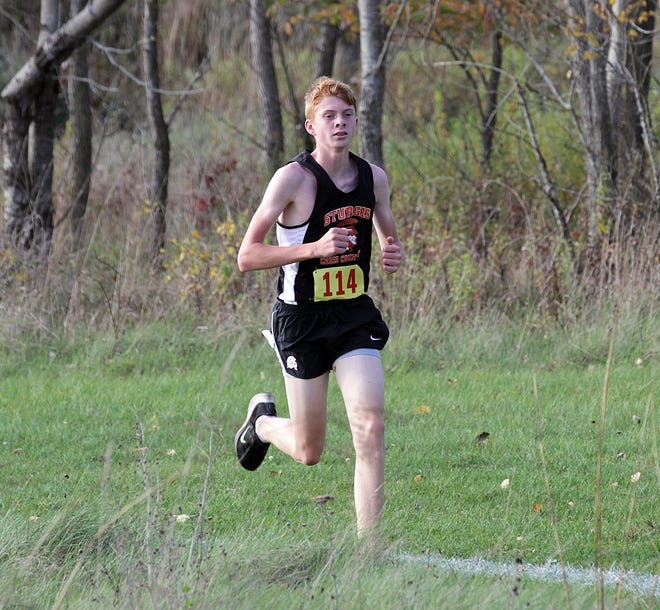 Zachary Green runs in a cross country event for Sturgis last fall. Green, a regional qualifier, will look to help lead the Trojans this year.