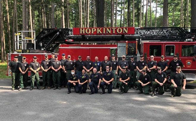 A team of Massachusetts firefighters headed west to help battle massive forest fires.