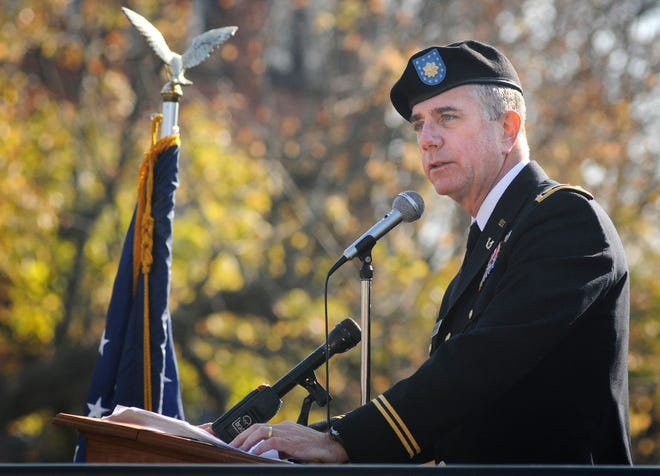 State Rep. Harold P. Naughton, Jr. speaks during the dedication of a World War I Monument in Clinton in 2012, after returning from a tour of duty in Afghanistan.