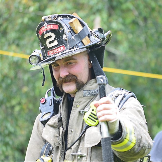Spencer Firefighter Patrick Murray during a fire in New Braintree on Aug. 7.