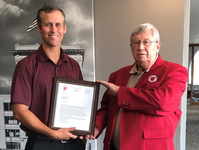 Sam Sicard (left), president and CEO of First National Bank of Fort Smith, receives an appreciation award from Keith Green, board member of the Arkansas Military Veterans' Hall of Fame. The bank has been a supporter of AMVHOF and is a member of its First 100 Contributors group of donors.
